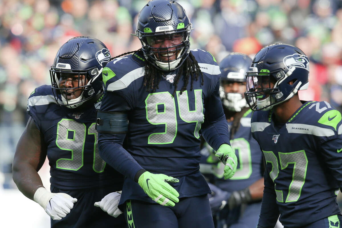 Seattle Seahawks defensive end Ziggy Ansah (94), defensive tackle Jarran Reed (91) and defensive back Marquise Blair (27) celebrate a sack in the first quarter of Seattle's game against Tampa Bay, Sunday, Nov. 3, 2019 at CenturyLink Field. The Seahawks won 40-34 in overtime.