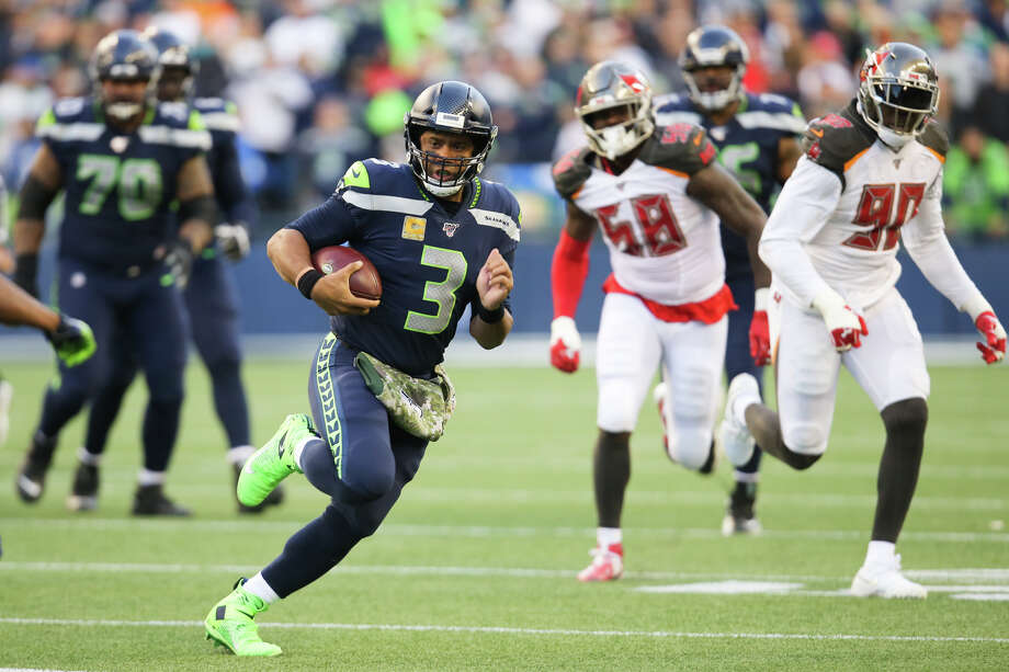 Seattle Seahawks quarterback Russell Wilson (3) picks up yards in the fourth quarter of Seattle's game against Tampa Bay, Sunday, Nov. 3, 2019 at CenturyLink Field. The Seahawks won 40-34 in overtime. Photo: Genna Martin, Seattlepi.com / GENNA MARTIN