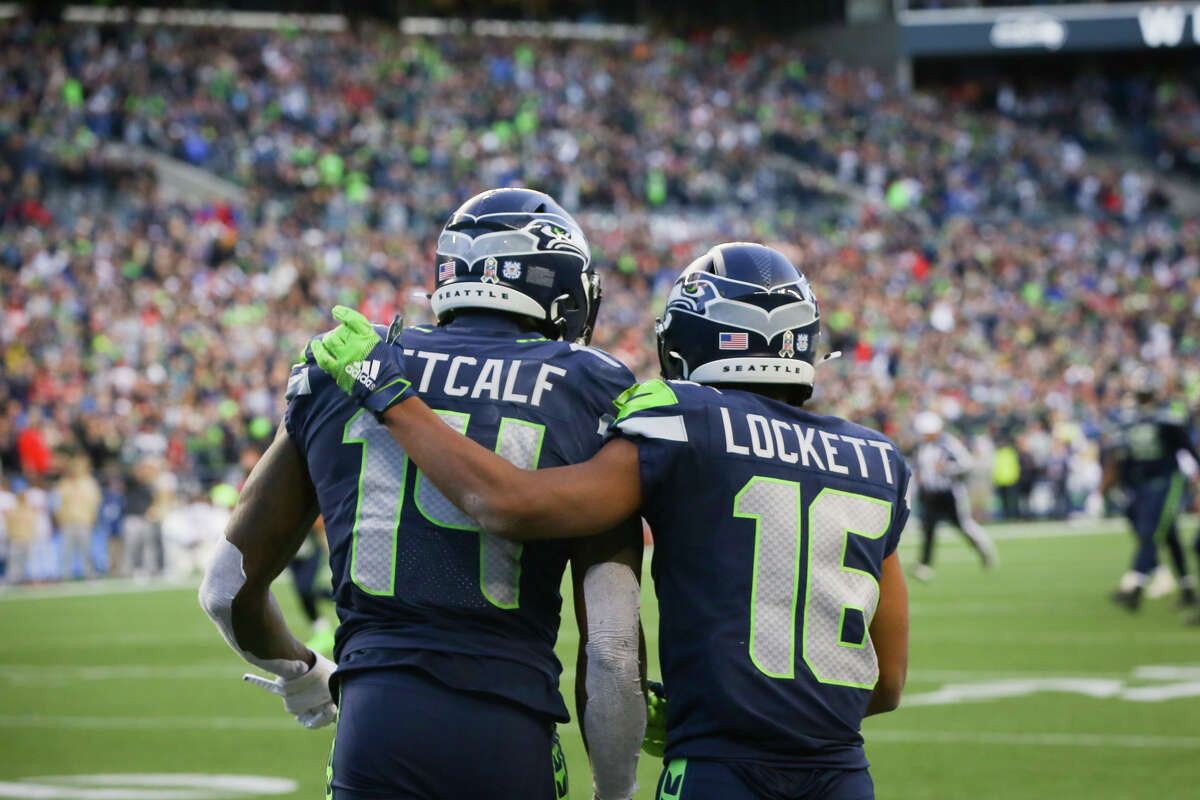 Seattle Seahawks wide receiver Tyler Lockett (16) hugs wide receiver D.K. Metcalf (14) after Metcalf caught a 29-yard pass during overtime in Seattle's game against Tampa Bay, Sunday, Nov. 3, 2019 at CenturyLink Field. The Seahawks won 40-34 in overtime.
