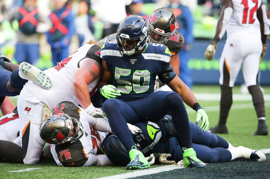 Seattle Seahawks outside linebacker K.J. Wright (50) sits atop the pile as the Bucs are stopped at the goal line in the second quarter of Seattle's game against Tampa Bay, Sunday, Nov. 3, 2019 at CenturyLink Field. The Seahawks won 40-34 in overtime. Photo: Genna Martin, Seattlepi.com / GENNA MARTIN