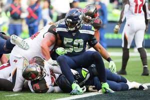 Seattle Seahawks outside linebacker K.J. Wright (50) sits atop the pile as the Bucs are stopped at the goal line in the second quarter of Seattle's game against Tampa Bay, Sunday, Nov. 3, 2019 at CenturyLink Field. The Seahawks won 40-34 in overtime.