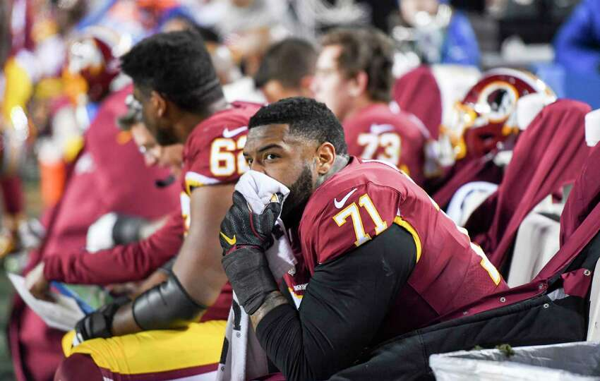 Washington Redskins offensive tackle Trent Williams sits on the bench.