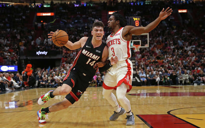 Miami Heat guard Tyler Herro (14) drives against Houston Rockets guard Chris Clemons (3) in the second quarter on Sunday, Nov. 3, 2019 at the AmericanAirlines Arena in Miami, Fla. (David Santiago/Miami Herald/TNS)