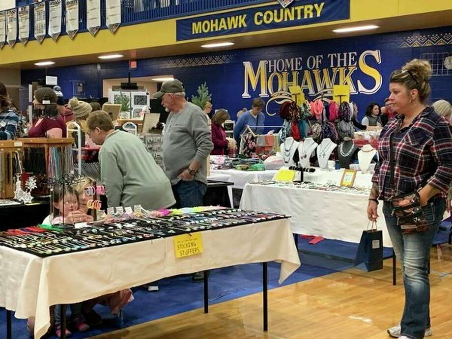 Shoppers came out in droves to take advantage of some early holiday shopping at the Morley Stanwood Holiday Bazaar on Saturday. In it's 30th year, the event gets bigger each year, said event coordinator Christine Persons. It is a great place to find unique gift items for the holidays, and proceeds go to support local students. (Pioneer photo/Cathie Crew)