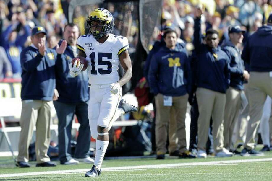 Michigan's Giles Jackson returns the opening kickoff for a touchdown during the first half of an NCAA college football game against Marylandon Saturdayu in College Park, Md. (AP Photo/Julio Cortez) / Copyright 2019 The Associated Press. All rights reserved