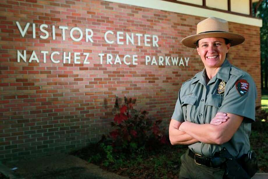 National Park Service Ranger Sarah Davis poses for a photo, Thursday, Oct. 31, 2019 in Tupelo, Miss. Davis, a 20-year veteran of the National Park Service, came to Tupelo in 2012 from an office in Washington, D.C. where she had a 76-mile commute one-way each day to work. Davis is heading to Yellowstone National Park, where she will become its first female chief ranger. (Thomas Wells/The Northeast Mississippi Daily Journal via AP) / The Northeast Mississippi Daily Journal