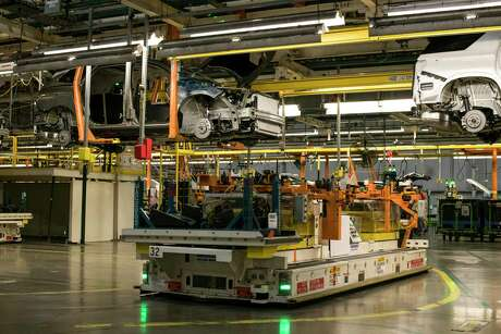 Buick vehicles on the assembly line at the General Motors Lansing Delta Township Assembly Plant in Lansing, Mich. The company and others have sided with the Trump administration in its battle over regulations designed to fight climate change.