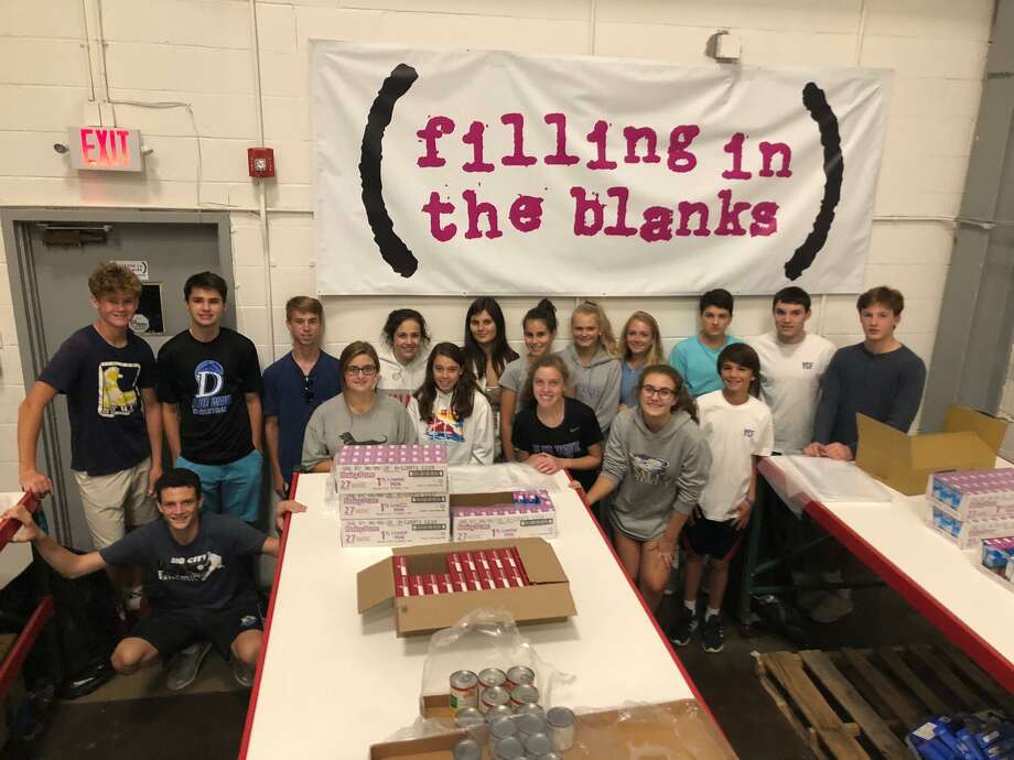 The Youth Community Fund met at Filling in the Blanks to help fight childhood hunger by providing children with food backpacks for the weekend when they would not have access to meals at school. Photo: Contributed