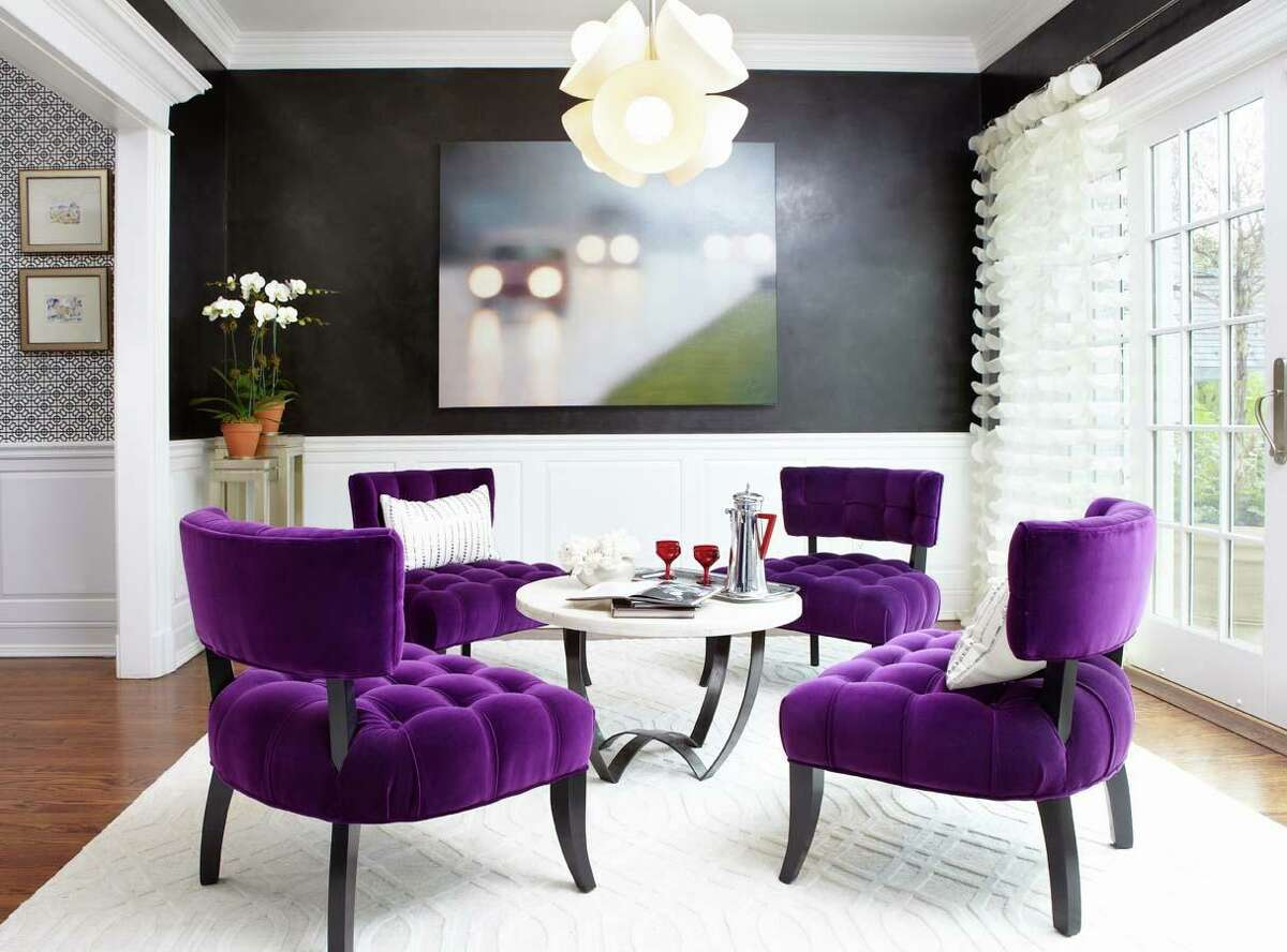 The purple chairs in this Westchester Showhouse space designed by Carey Karlan, principal interior designer of Last Detail Interior Design in Darien, are the perfect example of how velvet can create an impact and still look sophisticated and light.