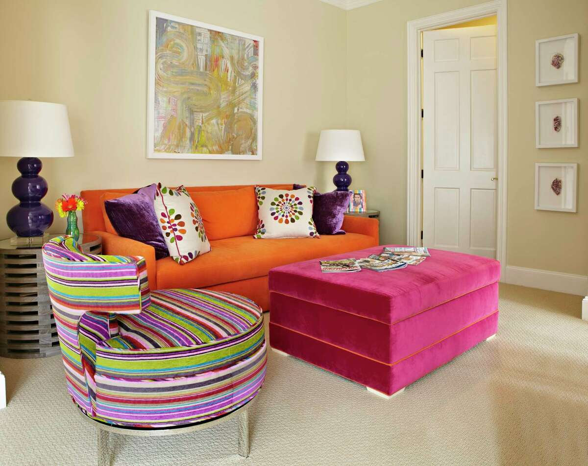 Velvet is durable and when used in bright, bold colors can be fun for kids and teenagers, like the ottoman and striped chair in this transitional playroom, designed by Carey Karlan, principal interior designer of Last Detail Interior Design in Darien.