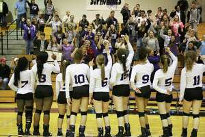 The Lady Broncos celebrate with their fans singing the school song after their historic win over the Vidor Pirates. It's the first time the volleyball team has been to the playoffs in four years.