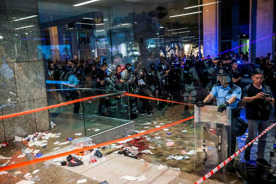 Police secure the scene late Sunday at a Hong Kong mall where a man slashed two people with a knife before biting off part of the ear of a local politician. Photo: Vivek Prakash / AFP Via Getty Images