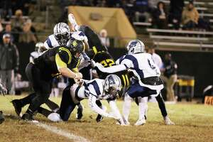 Panther BJ Peterson gets upended at the end of one of his runs Friday night in the Liberty loss to West Orange-Stark, 39-0.