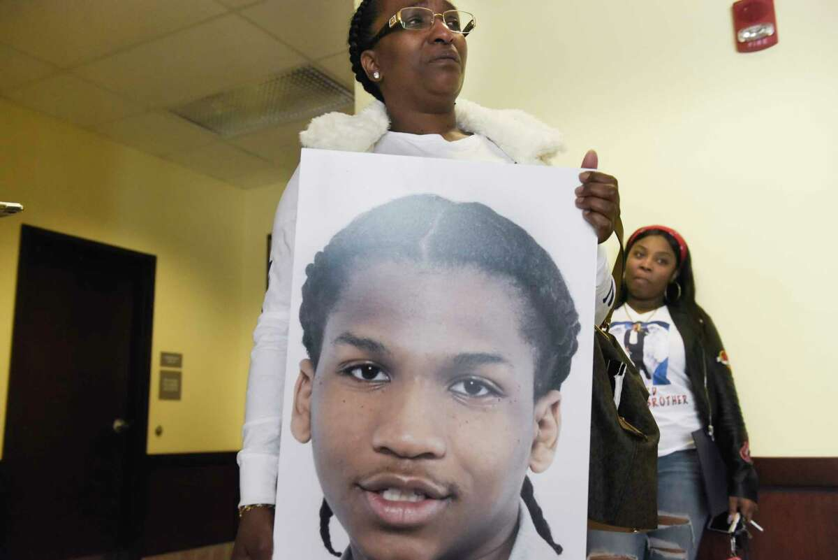 Lea Johnson holds a photo of her murdered son, Ty-son Williams, following the sentencing of his killer, Sha-mel Rush, at Albany County Court on Monday, Nov. 4, 2019, in Albany, N.Y. (Paul Buckowski/Times Union)