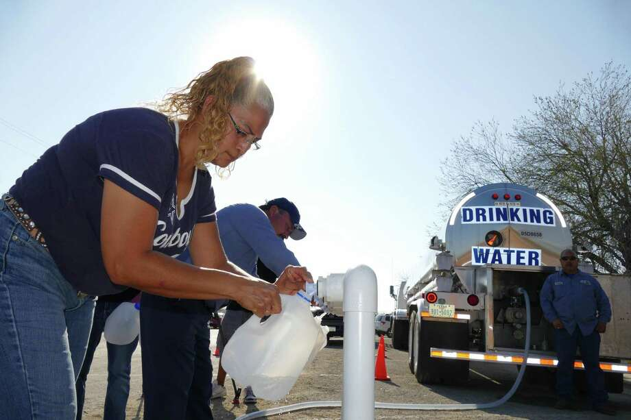 Clean water is essential, but it's been estimated more than 100 communities across Texas still lack basic water and wastewater infrastructure. Proposition 2 would help fix this. Here, a woman in Crystal City fills a gallon container after tainted water poured out of the faucets in the city in 2016. Photo: Billy Calzada /San Antonio Express-News / San Antonio Express-News