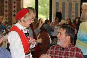 Table attendants wear traditional Scandinavian garb at the Scandinavian Bazaar and Luncheon.