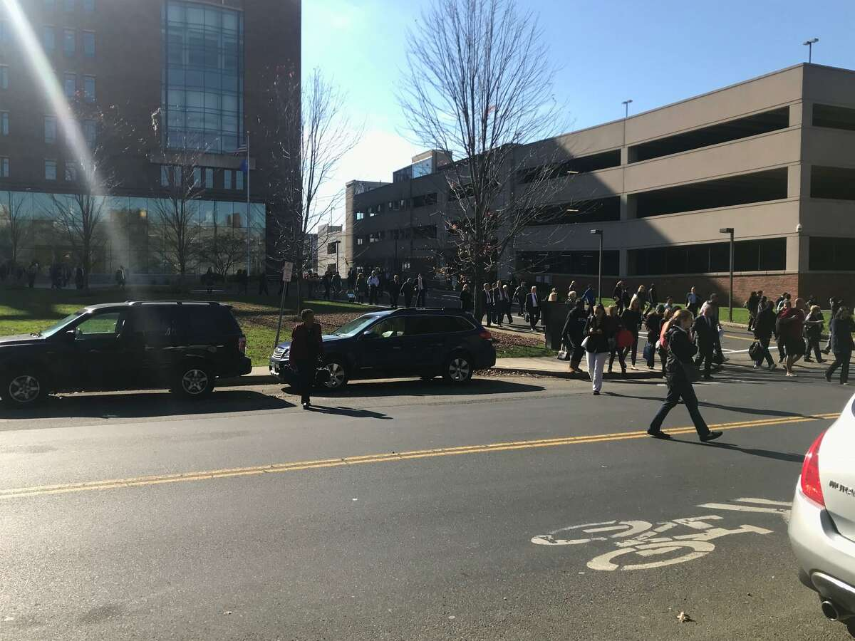 People are evacuated from Stamford Courthouse on Monday, Nov. 4, 2019.