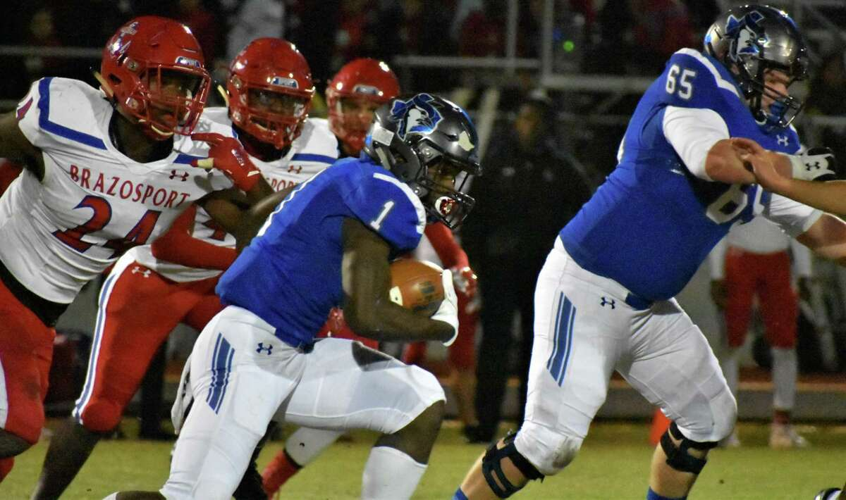 Needville's Ashton Stredick (1) runs behind Stephen Ashburn (65) during the Blue Jays' 48-35 victory against Brazosport, Nov. 1 in Needville. The Blue Jays improved to 8-1 overall, 5-0 in District 13-4A Division I.