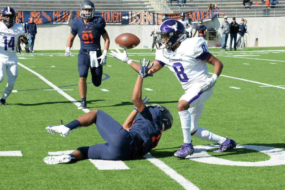 A pass intended for Braxton McDonald (14) of Seven Lakes is bobbled and intercepted by Jaelon Parker (8) of Morton Ranch during the first quarter of a 6A Region III District 19 football game between the Seven Lakes Spartans and the Morton Ranch Mavericks on Saturday, November 2, 2019 at Legacy Stadium, Katy, TX.