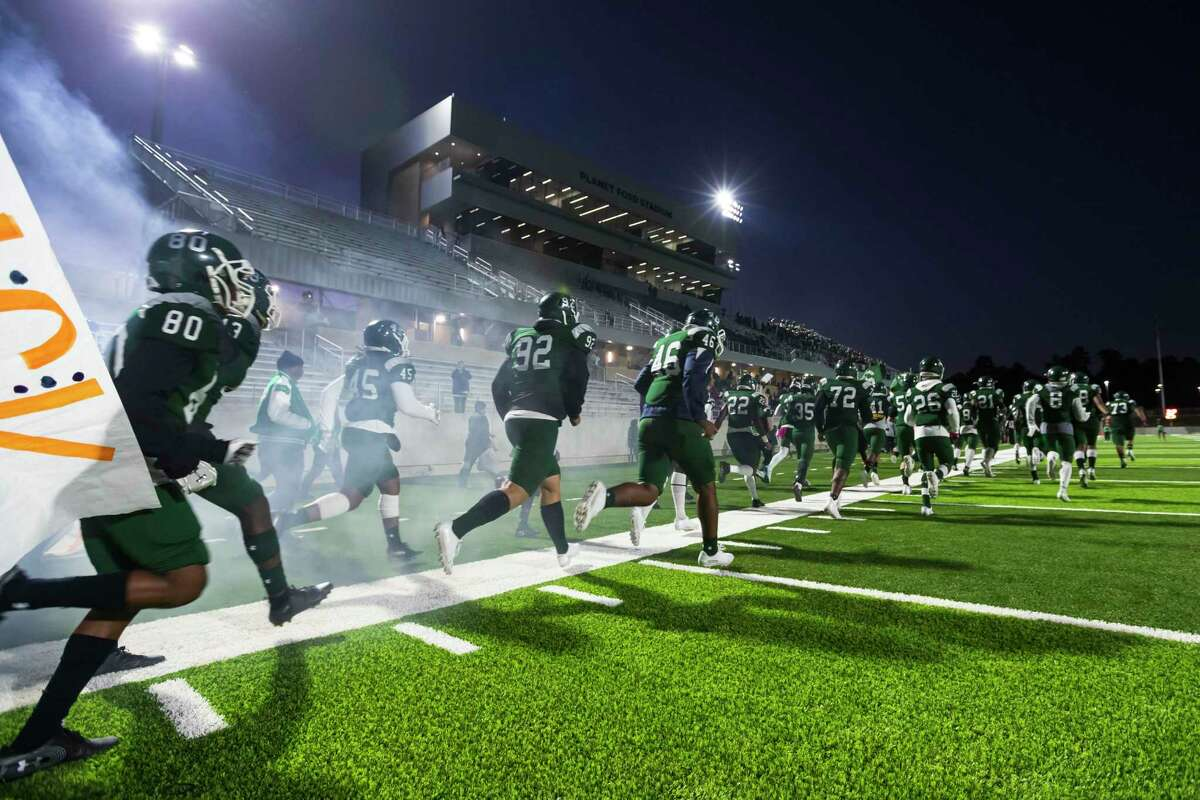 The Spring Lions run on the field for the first game to be played at Planet Ford Stadium, Oct 31, 2019, in Spring, Texas. Spring ISD's three schools in Spring, Dekaney and Westfield remained in the same district (14-6A) alongside the Aldine ISD schools Nimitz, MacArthur, Eisenhower, Aldine and Benjamin Davis for the 2020-2022 UIL Reclassification and Realignment.