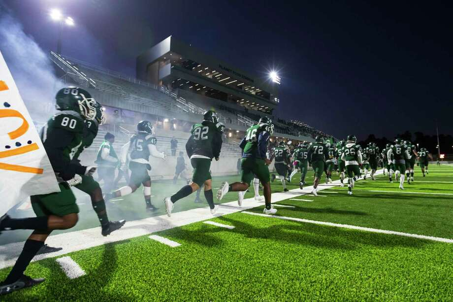 The Spring Lions run on the field for the first game to be played at Planet Ford Stadium, Oct 31, 2019, in Spring, Texas. Spring ISD's three schools in Spring, Dekaney and Westfield remained in the same district (14-6A) alongside the Aldine ISD schools Nimitz, MacArthur, Eisenhower, Aldine and Benjamin Davis for the 2020-2022 UIL Reclassification and Realignment. Photo: Joe Buvid, Houston Chronicle / Contributor / © 2019 Joe Buvid