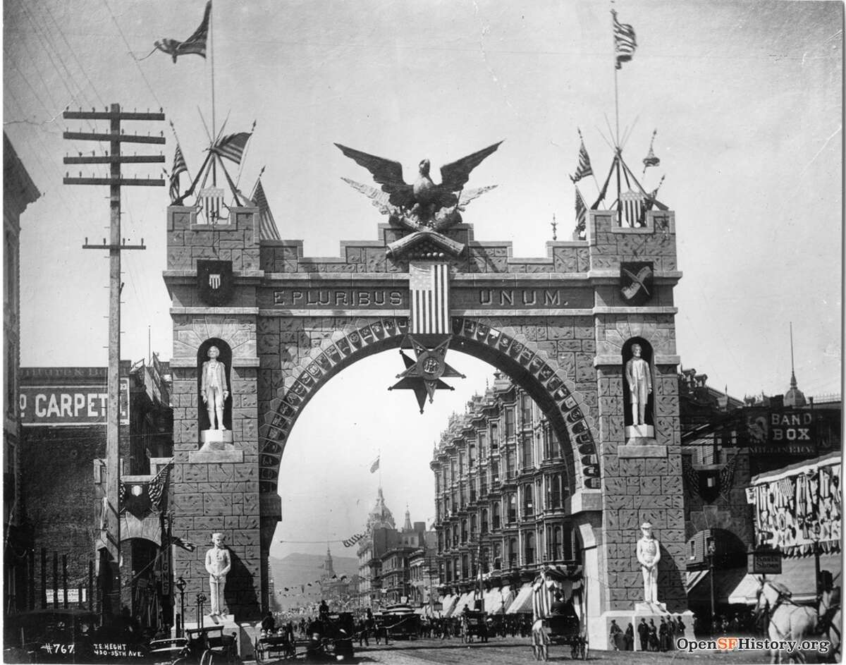 A closer look at the arch created for the National Encampment of the Grand Army of the Republic in 1886. The arch was over Market Street in San Francisco and featured giant statues of George Washington and Abraham Lincoln.