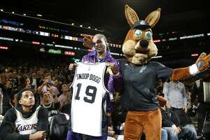 SAN ANTONIO,TX - NOVEMBER 03:  Snoop Dogg reacts after being given a spurs t-shirt by San Antonio Spurs Coyote at AT&T Center on November 03, 2019 in San Antonio, Texas.  NOTE TO USER: User expressly acknowledges and agrees that , by downloading and or using this photograph, User is consenting to the terms and conditions of the Getty Images License Agreement. (Photo by Ronald Cortes/Getty Images)
