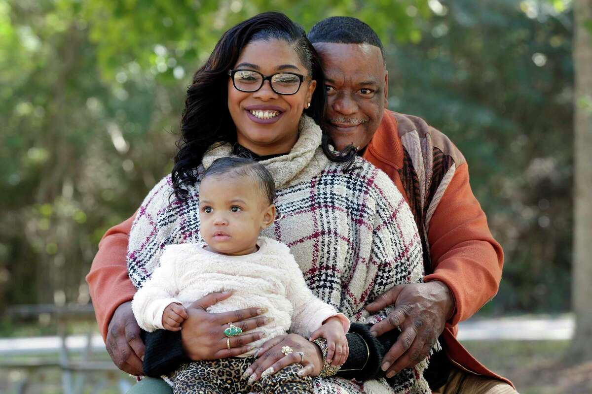 Genia Robinson, a victim of domestic abuse when she was pregnant with another man, with her husband Michael Mamou and one year old daughter Amia Estes at the Jesse Jones park Friday, Nov. 1, 2019 in Humble, TX.