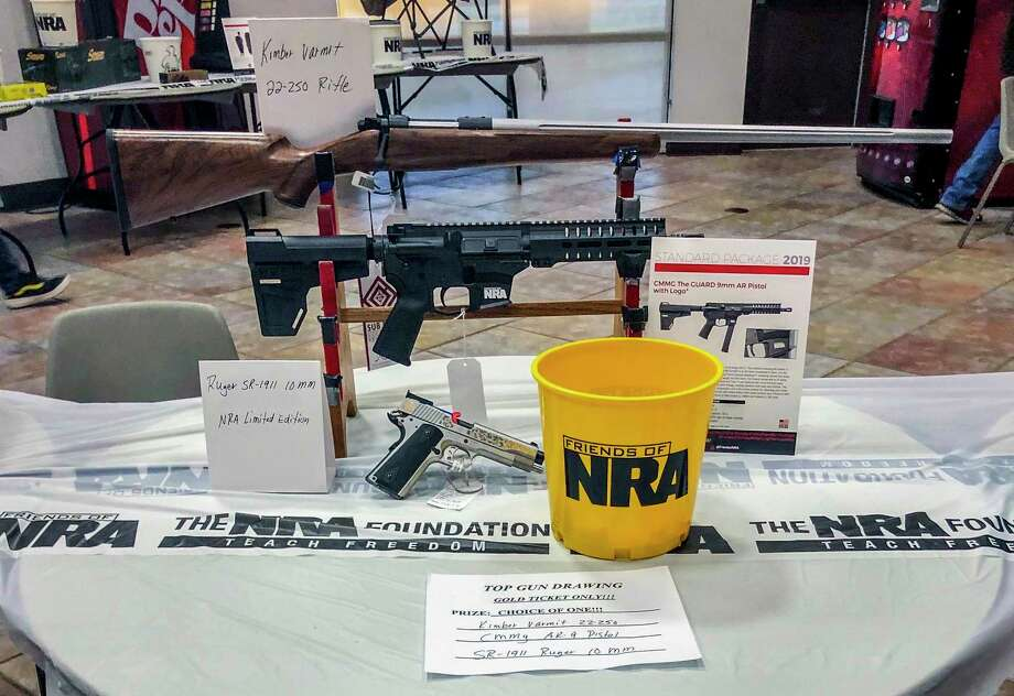 Shotguns and rifles are raffled by Friends of the NRA at a technology education center in Idabel, Oklahoma, on Sept. 14. Photo: Washington Post Photo By Neena Satija. / The Washington Post