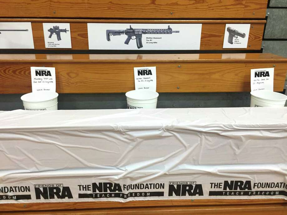 Semi-automatic rifles and handguns are raffled by Friends of NRA in the Muhlenberg County High School gym in Greenville, Kentucky, on Sept. 14. Photo: Photo For The Washington Post By Lloyd Smith. / Lloyd Smith