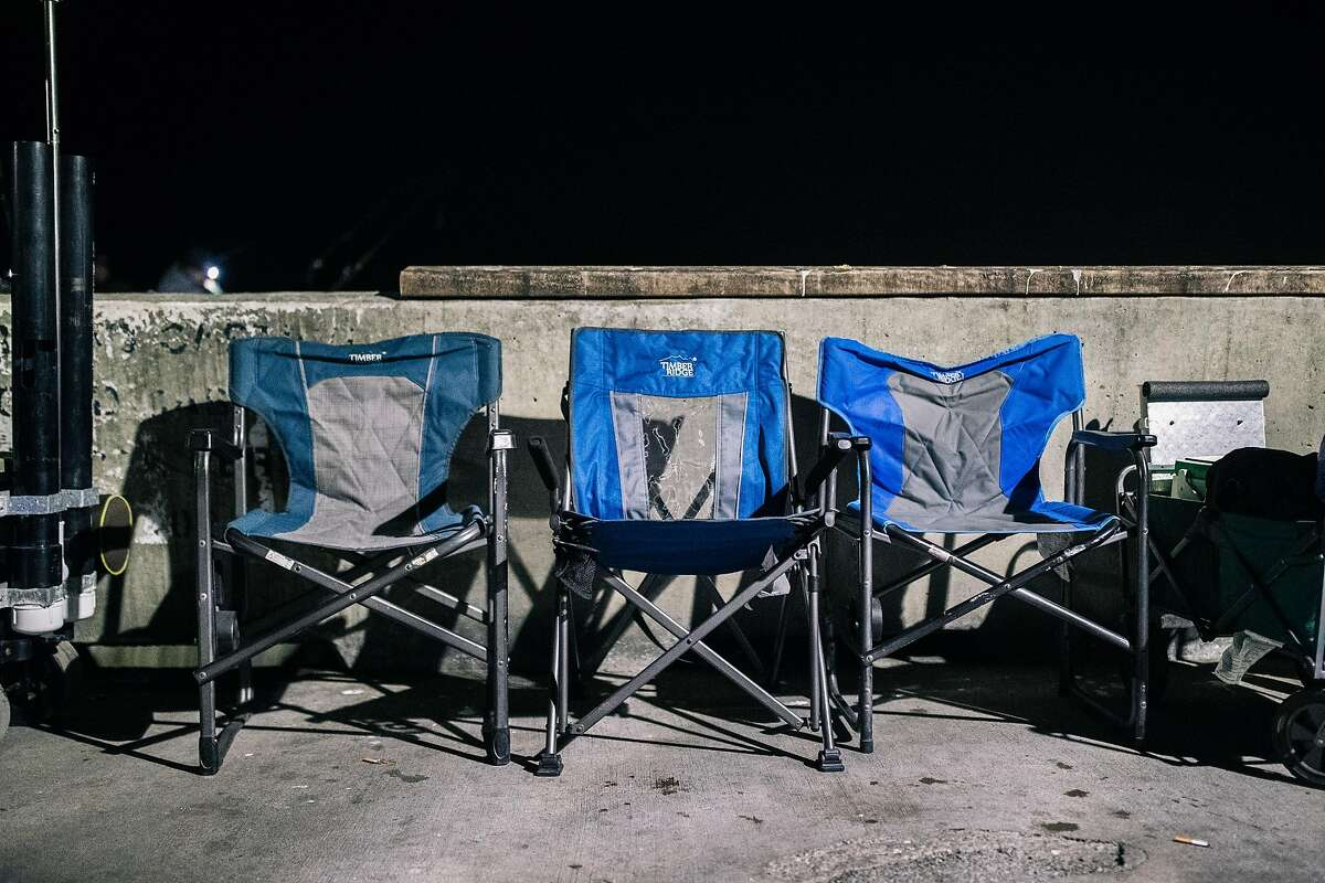 Camping chairs line a section of the Pacifica Municipal Pier during the opening day of California's recreational fishery for Dungeness crab season on Saturday, November 2, 2019 in Pacifica, California.