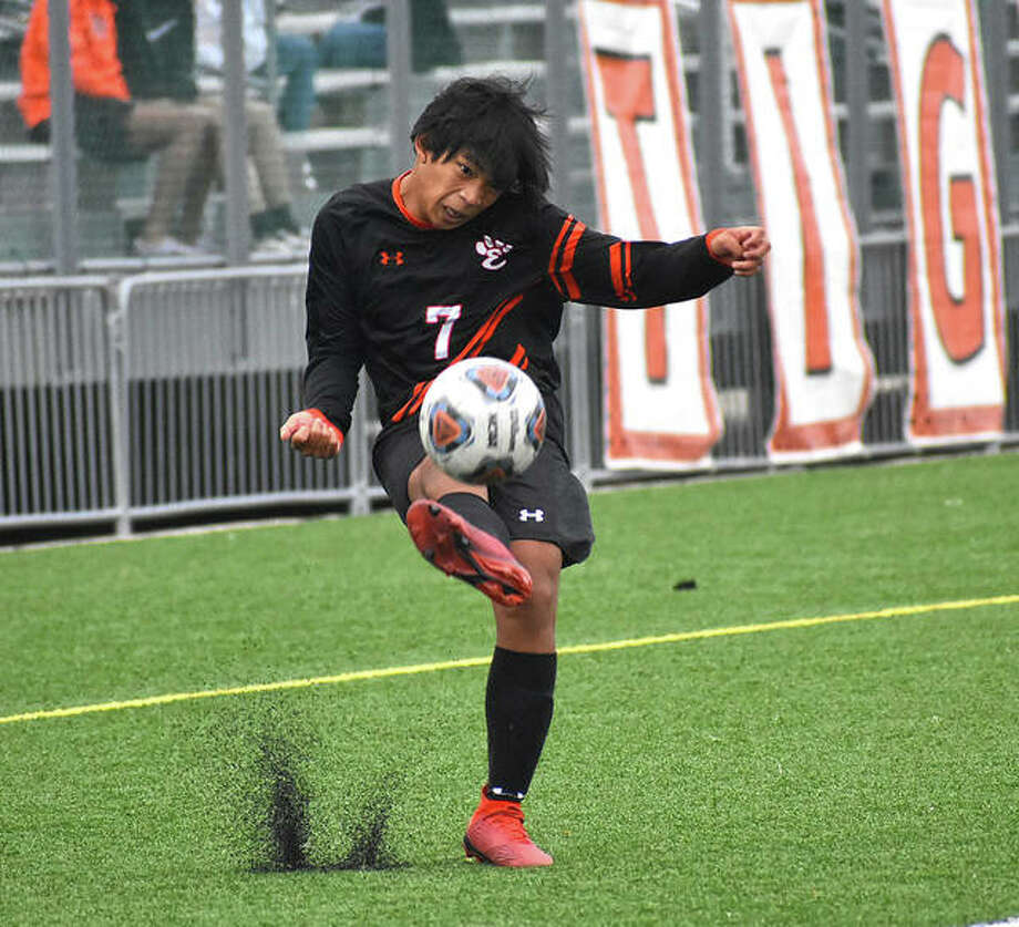 Edwardsville midfielder JT Watson blasts a ball into the box during the Class 3A Edwardsville Regional championship game against Alton. Photo: Matt Kamp|The Intelligencer