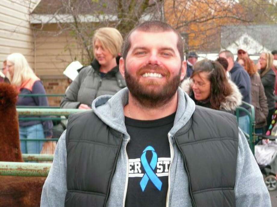 Brett Beiser, 35, smiles for the camera Saturday at an event in Auburn that helped raised money for his family as he battles late stage colon cancer. (Jon Becker/for the Daily News)