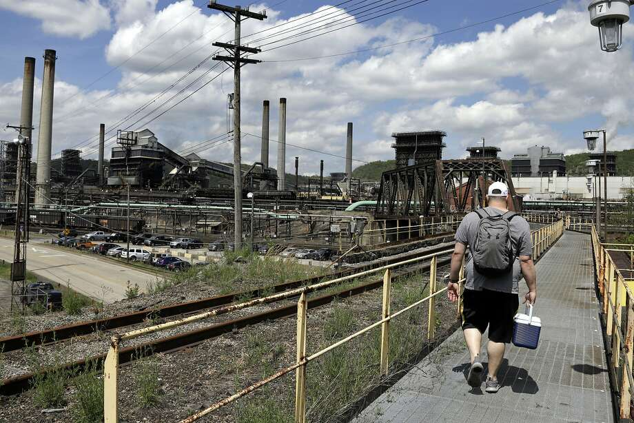 A worker arrives for his shift at U.S. Steel's Clairton (Penn.) Coke Works. Tariffs haven't had the promised effect. Photo: Gene J. Puskar / Associated Press