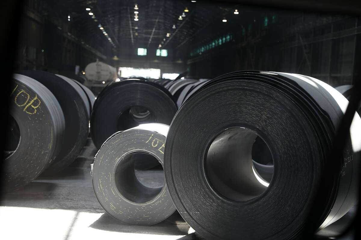 FILE - In this June 28, 2018, file photo, rolls of finished steel are seen at the U.S. Steel Granite City Works facility in Granite City, Ill. President Donald Trump's decision last year to tax imported steel tested the limits of his legal authority, strained relations with key U.S. allies and imposed higher costs and uncertainty on much of American industry. But his 25% tariffs haven't even done much for the companies they were supposed to help. (AP Photo/Jeff Roberson, File)