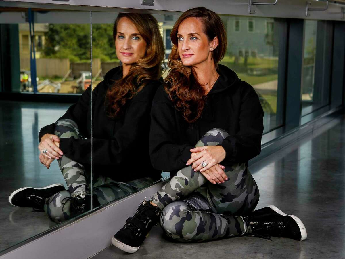 """Megan Eddings, who founded Accel Lifestyle, a clothing company who developed what they call """"anti-stink"""" fabric used in workout clothes, wears one of the company's new hoodies at Define studio in the Heights in Houston, Monday, Sept. 30, 2019."""