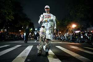 """A man dressed as """"Fake News Media"""" participates in the annual Village Halloween parade on Sixth Avenue on October 31, 2019 in New York. (Photo by Johannes EISELE / AFP) (Photo by JOHANNES EISELE/AFP via Getty Images)"""
