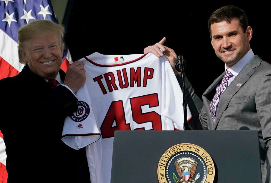 WASHINGTON, DC - NOVEMBER 04:  First baseman Ryan Zimmerman presents a Nationals jersey to U.S. President Donald Trump as Trump welcomes the 2019 World Series Champions, the Washington Nationals, to the White House November 4, 2019 in Washington, DC. The Nationals are Washingtons first Major League Baseball team to win the World Series since 1924. Photo: Win McNamee, Getty Images / 2019 Getty Images