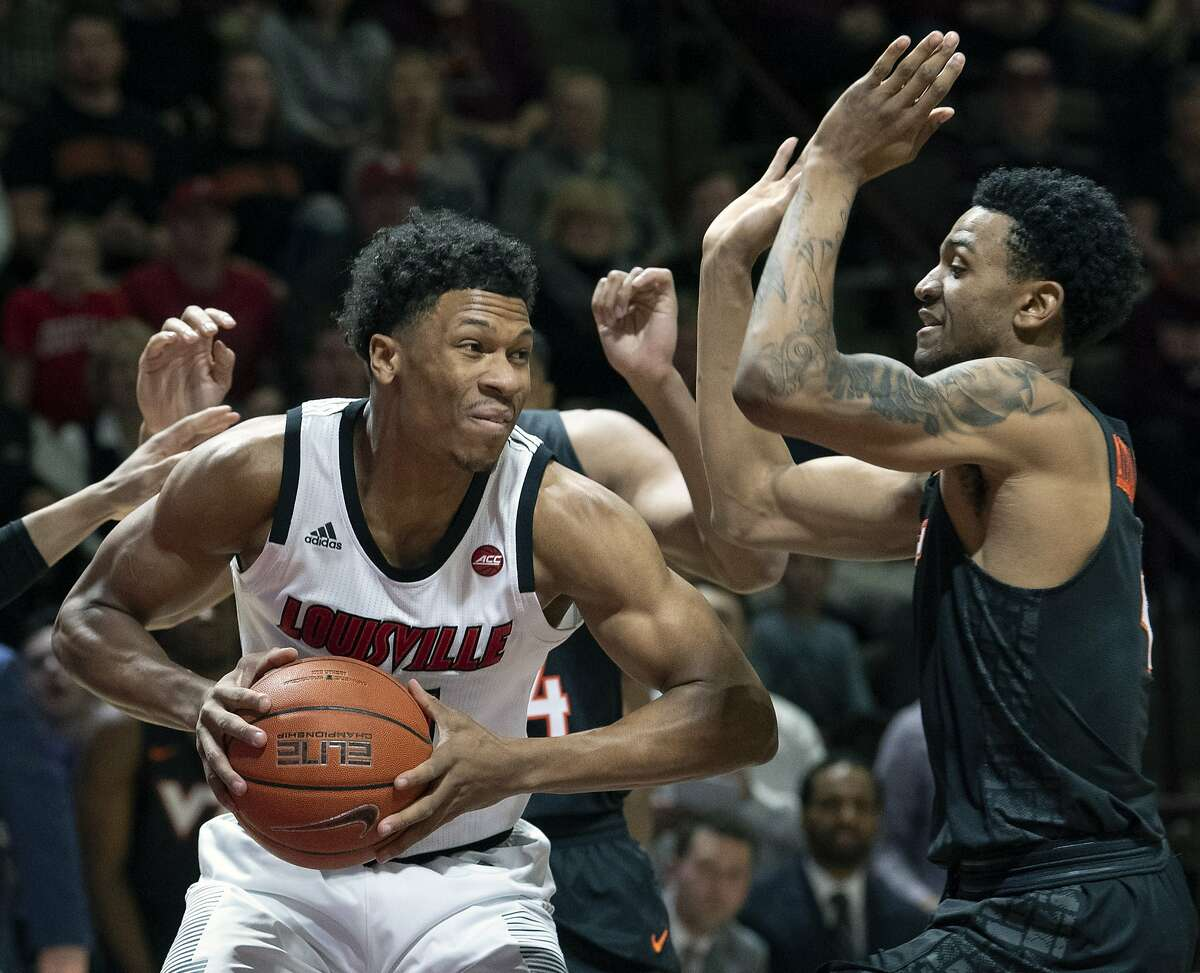 In this Feb. 4, 2019, file photo, Louisville forward Dwayne Sutton, left, looks to pass against Virginia Tech guard Nickeil Alexander-Walker (4) during the first half of an NCAA college basketball game, in Blacksburg, Va. Louisville is back in the national championship conversation after the basketball program was knocked on its heels amid the fallout of embarrassing scandals, including the school's missteps that were discovered in a federal investigation into college basketball and escorts performing in players' dorm.