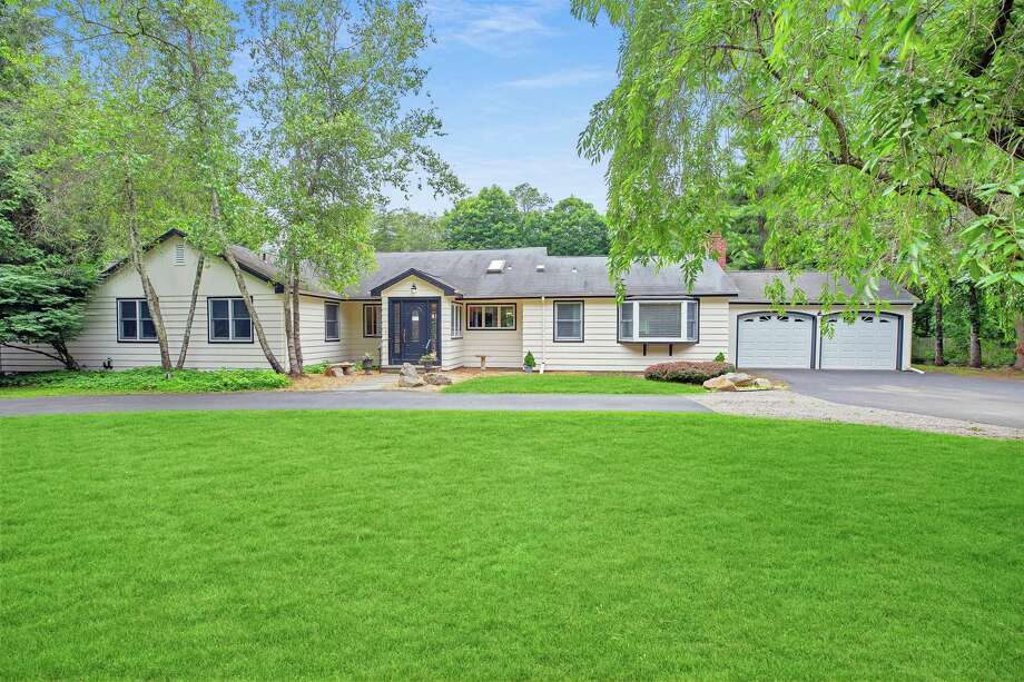 The 2,516-square-foot house at 11 Blueberry Hill Road in Weston sits on a level property of just over one acre.