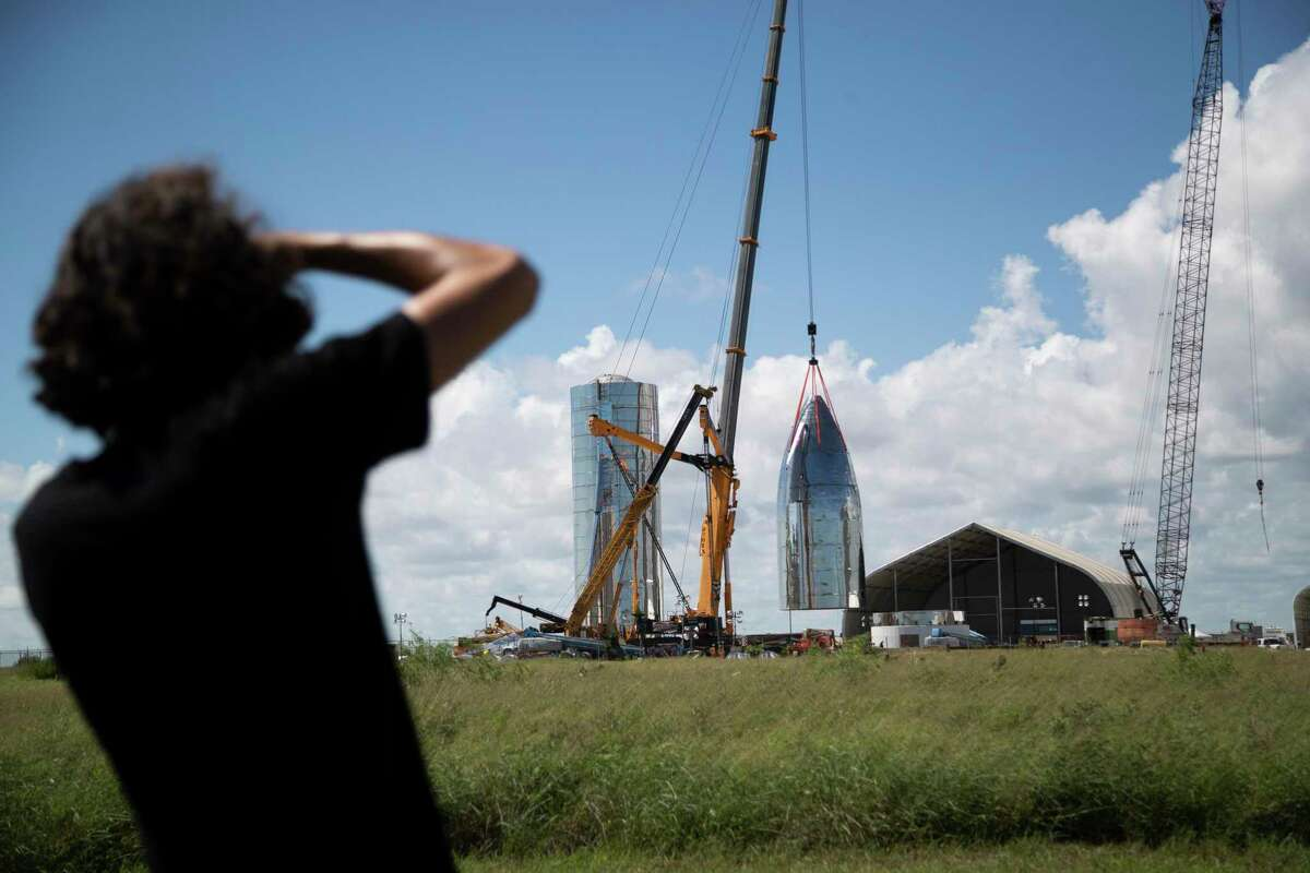 Austin Barnard, 21, photographs the SpaceX Starship prototype in Boca Chica on Friday, Sept. 27, 2019. Barnard became part of the space community after taking a picture of the Starhopper, a now retired prototype that was designed to test the Raptor engine and other spacecraft systems, and posting it to Twitter.