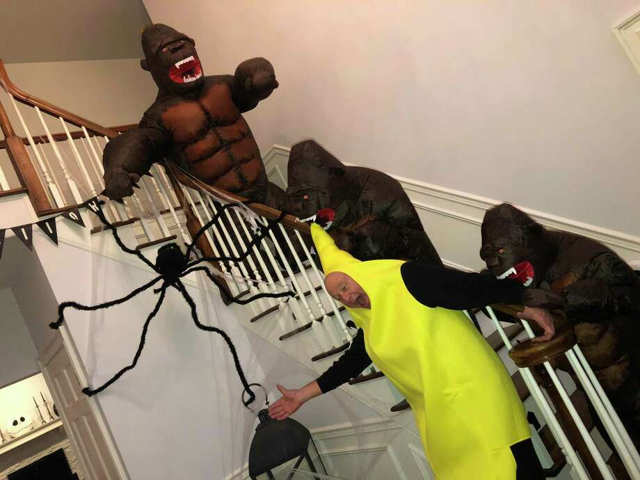 Three Farmingville-area students — Luke, 11, Helena, 9, and Dominic, 7 — were awarded first place in the Nod Hill Brewery Halloween costume contest on Oct. 31. The three students dressed as gorillas chasing a frightened banana. Photo: Kerri Ungaro / Contributed Photo