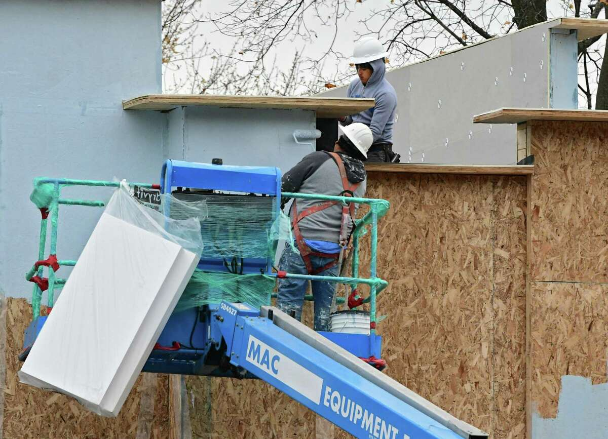Workers are seen doing construction on a new building on the corner of Western Ave. and McKown Rd. on Monday, Nov. 4, 2019 in Albany, N.Y. (Lori Van Buren/Times Union)