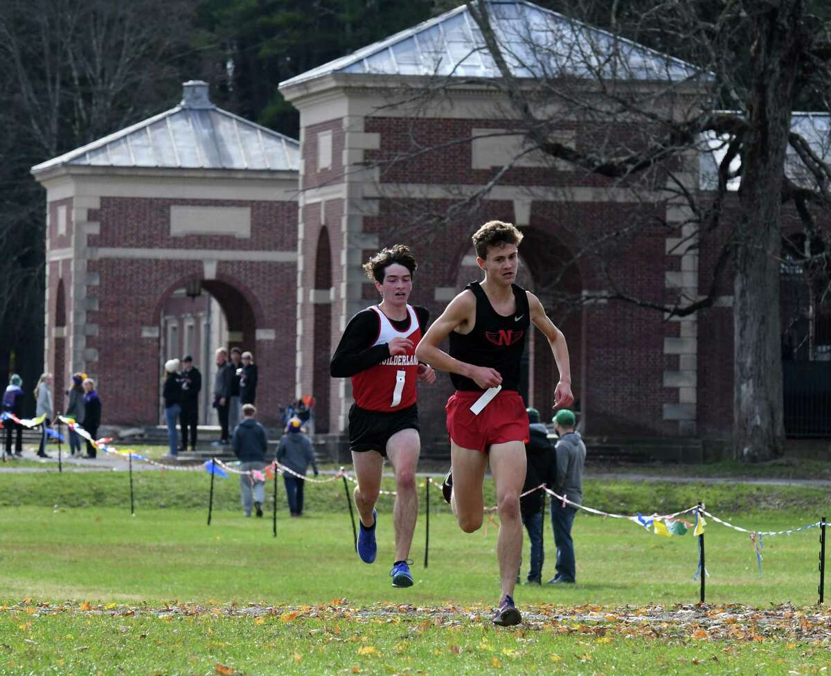 Thomas Ragone of Niskayuna, right, and Sean O'Brien of Guilderland, left, finish first and second in the Section II Cross Country Championships Class A boys' race on Monday, Nov. 4, 2019, at Saratoga Spa State Park in Saratoga Springs, N.Y. (Will Waldron/Times Union)