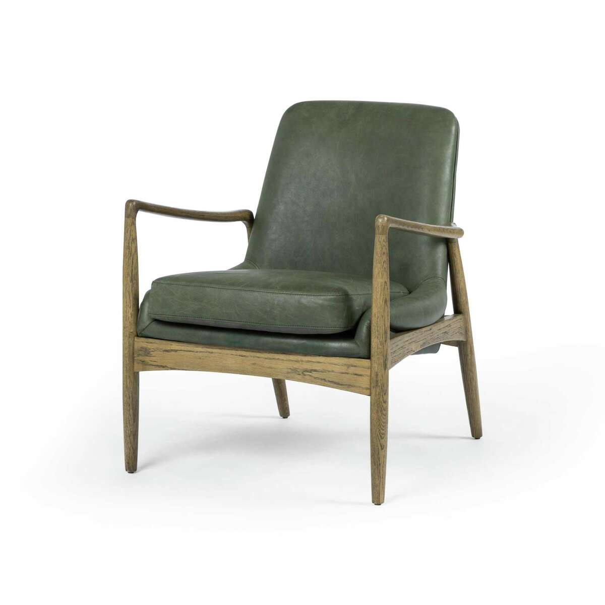 Four Hands' Braden chair is upholstered in muted green leather. It was part of new collections shown at the Fall 2019 High Point Market.