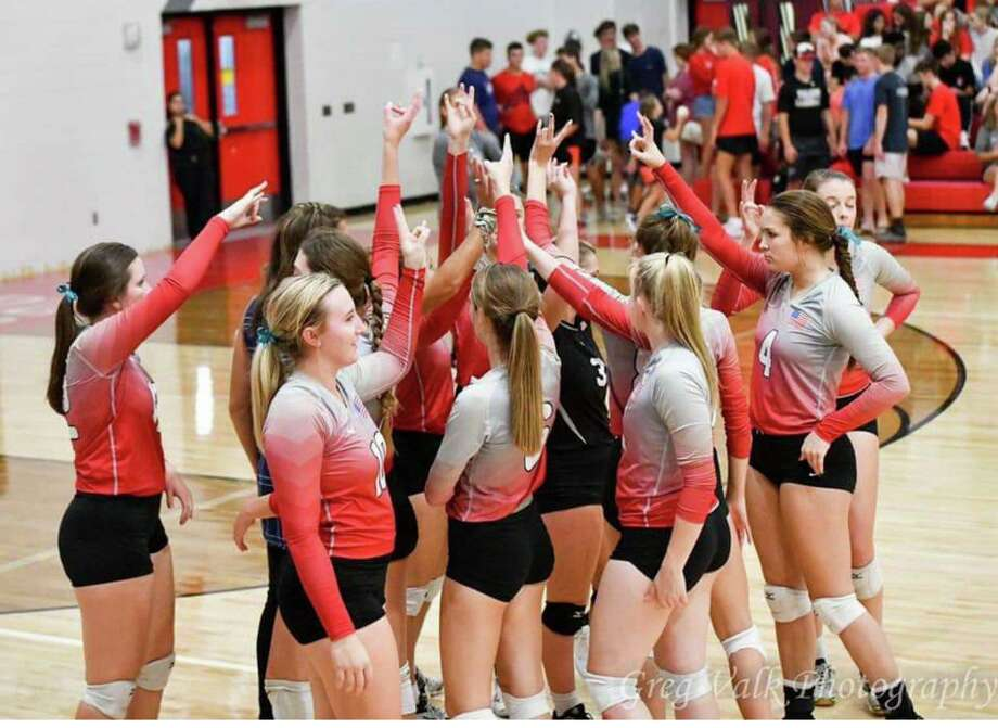 The Hargrave Lady Falcon volleyball team celebrates after beating Livingston 3-0 at the Falcons' Nest in Huffman on Oct. 4. Photo: Huffman Sports Media Twitter, @MediaHuffman