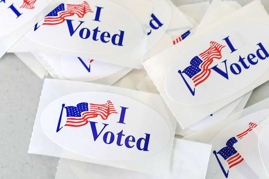 """""""I Voted"""" stickers at a polling station at UC Irvine in November 2018. Photo: Robyn Beck / AFP / Getty Images"""