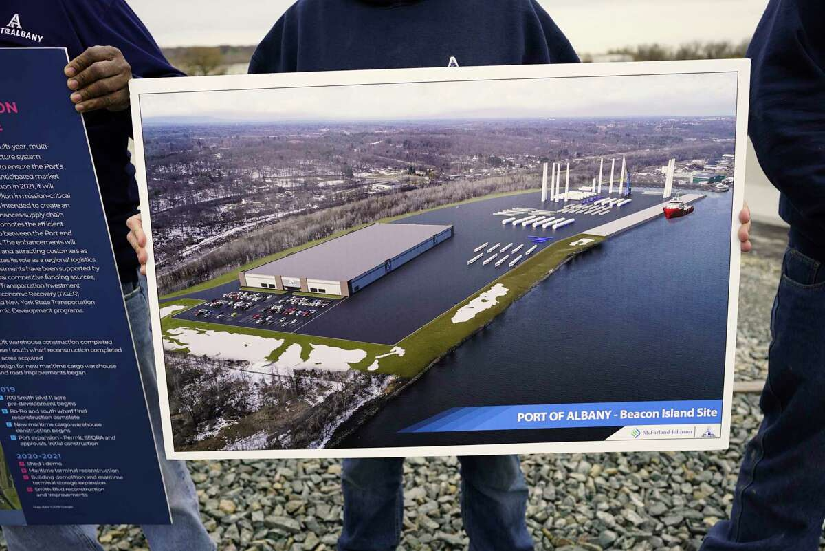 An artists rendition of an 80-acre expansion of the Port of Albany with a proposed new warehouse, is held by a port worker on Monday, Nov. 4, 2019, in Albany, N.Y. (Paul Buckowski/Times Union)