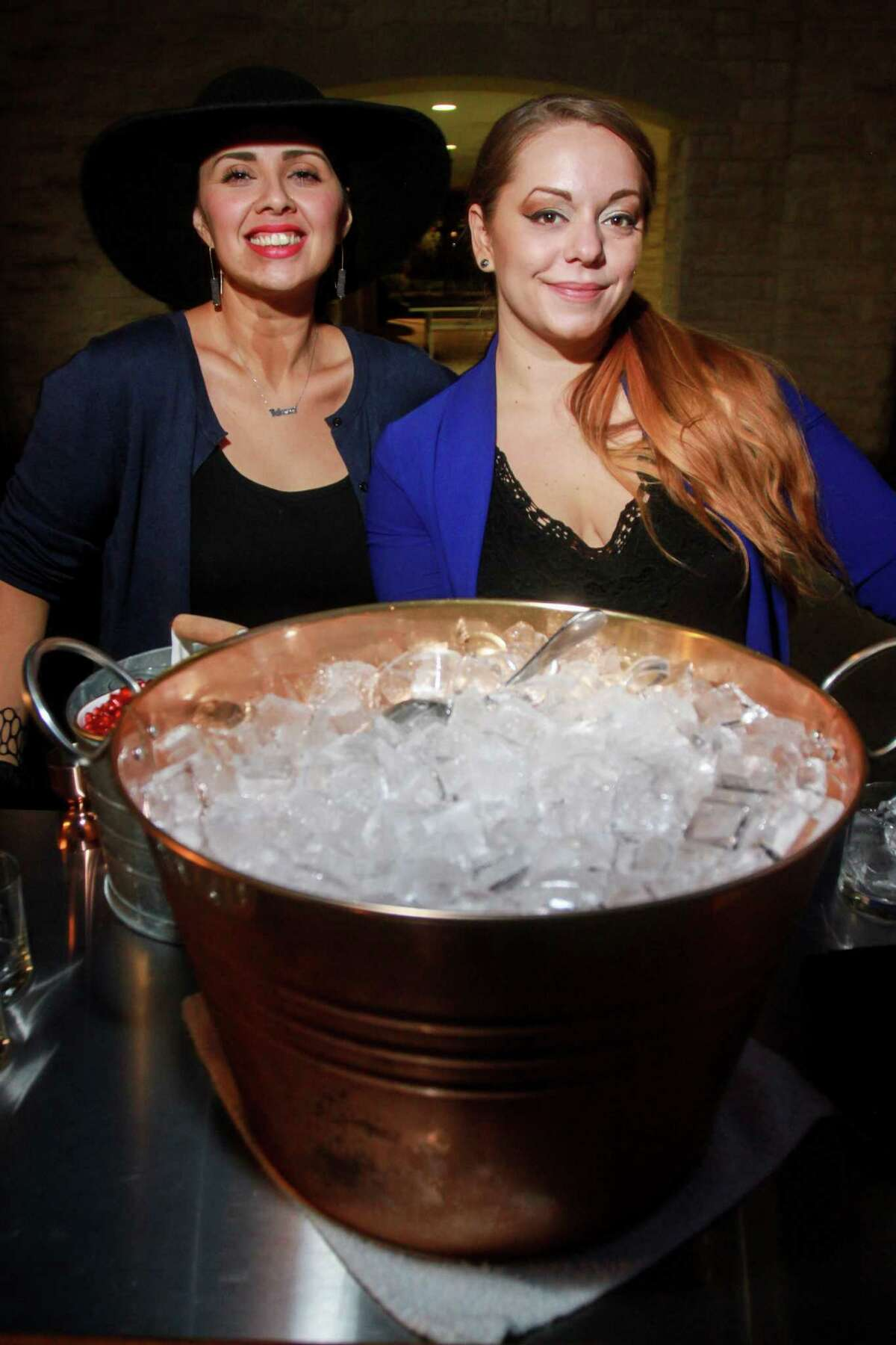 Linda Salinas, left, and Jess Householder as Urban Harvest celebrates its 25th anniversary with five-course meal prepared by 25 celebrity chefs at St. John's School on November 3, 2019.