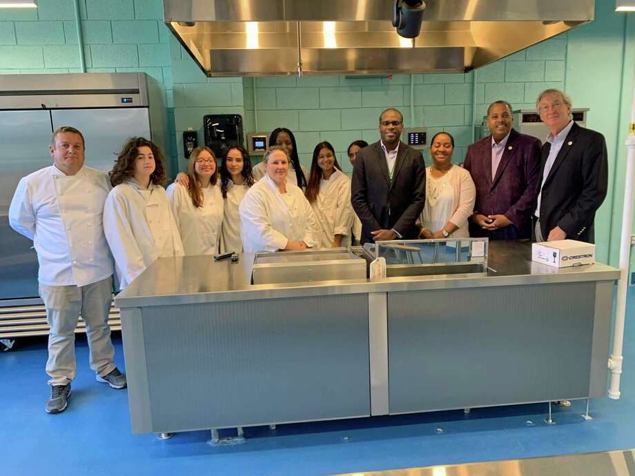 Norwalk High School culinary students and teachers, alongside Principal Reginald Roberts and Director of Norwalk's P-Tech School Karen Amaker, and Common Council members Greg Burnett and Tom Livingston, Nov. 4, 2019. Photo: Justin Papp
